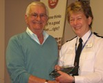 Mike Saunders receiving his Achievement Award on retiing from the Group (from President DCC Logan)