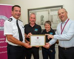 2019 Being presented with our Road Funding award l-r Chief Constable Nick Adderley, Chair John Norrie, Newsletter/Social media officer Henny Cameron, and Police, Fire and Crime Commissioner Stephen Mold
