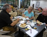 2018 August 3 in a car; David, Tess and Steve, and a pile of toast belonging to the group photographer!