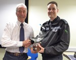 AGM: PC Dave Lee being awarded our President's Award (by Chair John Norrie) to thank him for his support to us during 2017