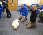 First aid training May 2018 - husband and wife team Steve and Tess waiting for defribillator to shock the patient