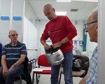 First Aid evening: Ian Phillips demostrating the different types of hemet and how they fasten.