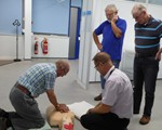 First Aid evening: Alan brown having a go, being watched by Rod Wyles and David Smith.  Aidan Ward, our paramedic university lecturer watches on.