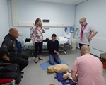 First Aid evening: Adam Jeskins (first responder and Special Constable) left, guides Catherine Tew, Chris Tew, Dean Harris and Dean's wife on CPR