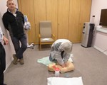 First Aid evening: Jens Ronne practices CPR whilst David Reeves waits his turn!