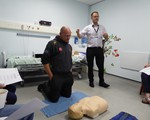 First Aid evening: Adam preparing himself for the CPR whilst Aidan does the talking!