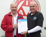 Ed Patrick receiving his test certificate from Associate officer Ian Phillips
