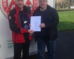 Marc England receiving his certificate from his observer (and Chair of the group), John Norrie.