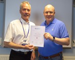 Anthony Jackson receiving his certificate from Chairman John Norrie