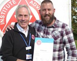 Richard Ellson receiving his F1RST certificate from chaiman, John Norrie