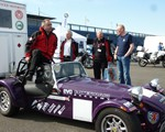 Open Roads, time to go.  David Reeves climbing into his Caterham 7 !