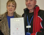 Our 900th test pass, Sally Nicholls, receiving her certificate from our Chairman John Norrie