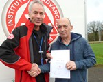 Tony Worsted receiving his certificate from Chair, John Norrie.