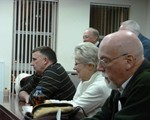 Roger Loomes, Tess Moore and John Hodges lkstening intently at IAM Trustee visit.