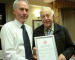 Peter Davey recieivng a certificate of appreciation following his retirement as Observer