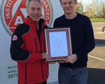 Sam Aitchison receiving his Advanced Test Certificate from Chair, John Norrie