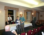 henny Cameron receiving the Caithness Award from Dr John Bond OBE