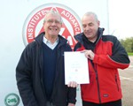 Arthur Hawker receiving his Advanced Test certificate.