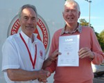 Bill Mead  receiving his Advanced Test certificate.