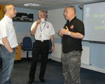 Classroom session with Chair John Norrie (middle) and IAM examiner Andy Giddings (right) talking to Steve Layton (left).
