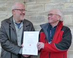 Frank Sudlow receiving his Advanced Test certificate from his observer, Graham Ward.