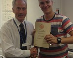 Our new Obsever, Gary Liddle, receiving his certificate from chair John Norrie