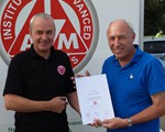 Graham Morris receiving his IAM certificate, from Ian Phillips (Associate officer)