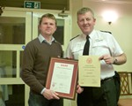 Ian Bird being presented with both his Advanced test certificate and hos Observer Certificate by president Inspector Nigel Rickaby