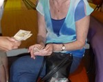 Our Treasurer, Ann, counting the money at our 35th Anniversary Bowling evening