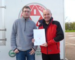 Chris Church receiving his Advanced Test certificate from Ian Phillips.