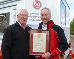 Rod Baker receiving his Observer certificate from Chair, John Norrie.